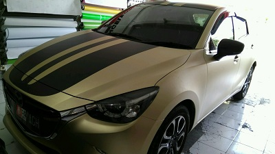 wrapping stiker mobil | Mazda 2 Soft Gold RS Premium | mangele stiker 081227722792